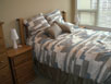 2 queen beds. Premium bedding. Thumb